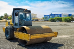 Roller compactor machine flattens the asphalt